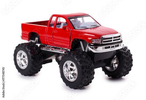 Plakat duży metal czerwony samochód zabawka offroad z kołami potwora na białym tle