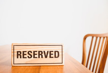Wooden Reserved Sign With Capi...