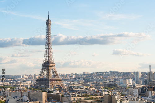 Photo Stands Paris famous Eiffel Tower and Paris roofs, Paris France