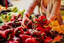 Woman Choosing Vegetables At T...