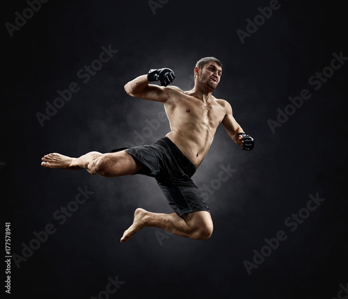Photo Stands Martial arts male fighter