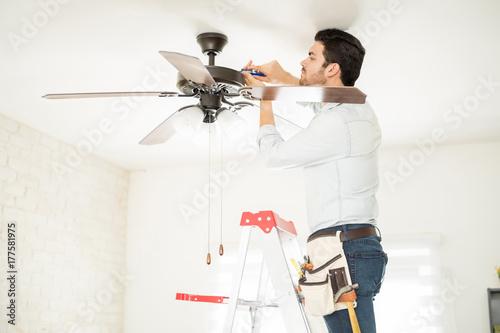 Fototapeta Handyman installing a ceiling fan obraz