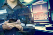 Double exposure of Engineer or Technician man in working shirt working with smart phone in control room of oil and gas platform or plant industrial for monitor process, business and industry concept