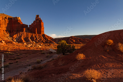 Fotobehang Bruin Moody red Chimney Rock and shadowy trail at Capitol Reef National Park in Utah.