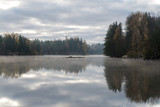 Calm lake in misty morning. - 177599300