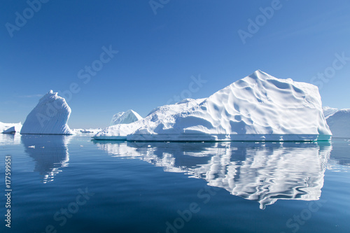Poster Antarctica Icebergs reflect in the water in Pleneau Bay, Antarctica