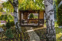 Wooden Summer House In The Garden