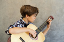 Teen Boy Playing Acoustic Guitar
