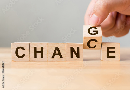 "Photo  Hand flip wooden cube with word ""change"" to ""chance"", Personal development and c"