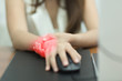 Selective focus Woman with pain in wrist , Office syndrome concept.