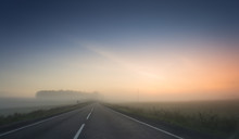 Summer Rural Landscape With Blue And Red Sky, Fog And The Road. Sunrise