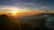 Sunrise nature landscape of Java island in Indonesia. Clouds, mountains and fog. Panning shot, UHD 4K