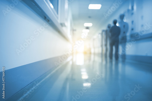 Fotografiet  Doubled silhouette of medical worker in hospital hall, unfocused background