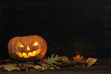 Old Pumpkin Halloween On A Dar...