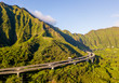 Green cliffs and mountains on the island of Oahu, Hawaii with the world famous Haiku stairs or the stairs to heaven.