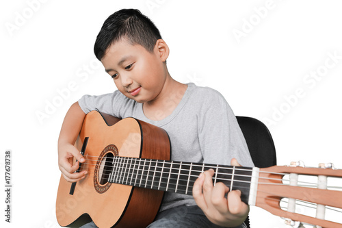 Cute boy playing acoustic guitar Fototapet