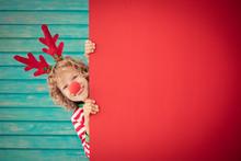 Funny Kid Holding Cardboard Ba...