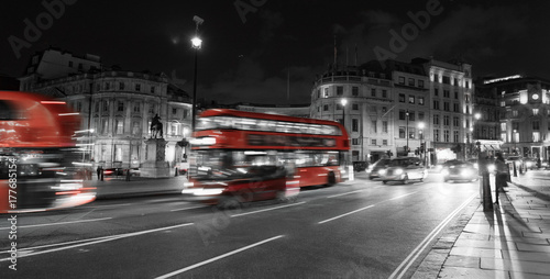 Vibrant London night scene at Trafalgar Square Poster