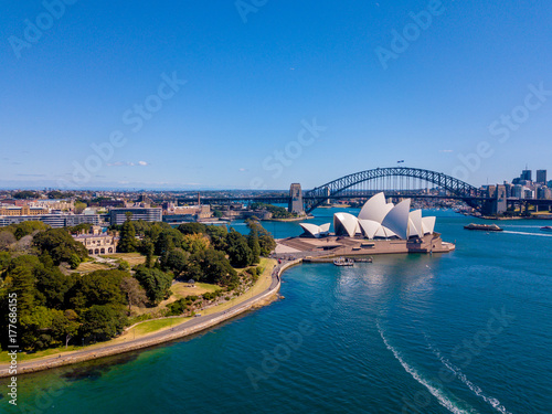 Staande foto Sydney Aerial Sydney view with the Opera house right by the Sydney harbour. Beautiful town. Australia.