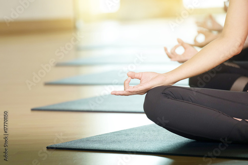 Fotoposter Ontspanning Young people praticing yoga indoors, hand close up with copy space, well being, wellness, healthy lifestyles