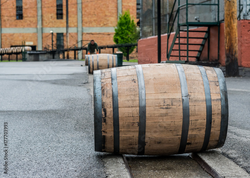 Bourbon Barrels Rolling Down Metal Track