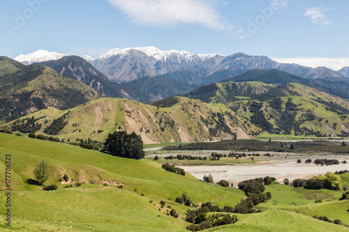grassy hills above Clarence river valley in springtime, South Island, New Zealan Wallpaper Mural