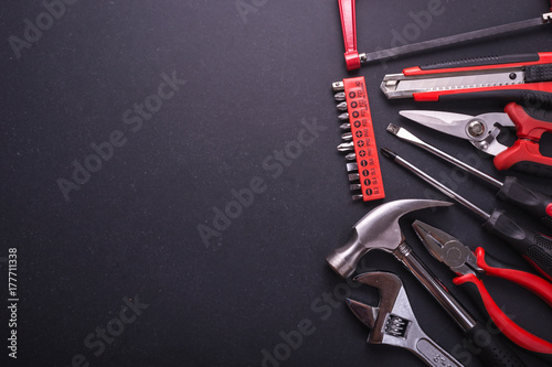 Carta da parati New square black tool box on black granite board background