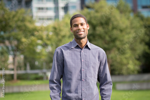 Fotografie, Obraz  Portrait of young African American man in residential neighborhood in the city