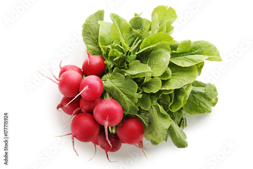 Red radishes isolated on white background