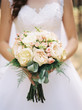 canvas print picture wedding bouquet in bride's hands
