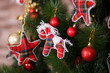 Christmas green pine tree decorated with red colourful toys stars balls sox and horse in studio shoot scene of new year holiday decorations