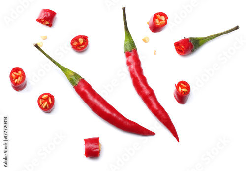 Tuinposter Hot chili peppers sliced red hot chili peppers isolated on white background top view