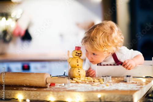 Fotografie, Obraz  Toddler boy making gingerbread cookies at home.