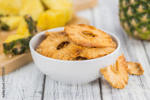 Fresh made Pineapple rings (dried) on a rustic background