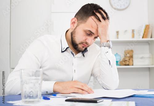 Photo Man struggling to pay bills
