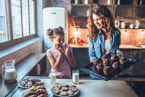 Mom with daughter on kitchen. Wallpaper Mural