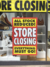 Closing Down Sign In A Shop Window In Vertical Format