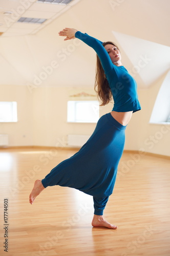 Beautiful Woman Practices Yoga Asana Ardha Chakrasana Standing Backbend Pose In The Yoga Studio Buy This Stock Photo And Explore Similar Images At Adobe Stock Adobe Stock