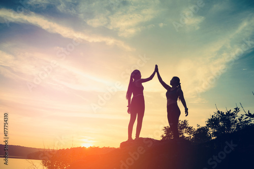 real success story in the mountain,sport couple woman with successful with sunse Canvas Print