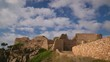 Nice castle in a village Fosca in a Costa Brava in Spain, with many clouds, time lapse