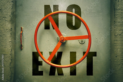 Photo  No exit warning on the hermetic bunker door with red handwheel