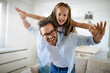 canvas print picture - Portrait of father and daughter playing at home