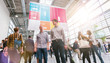 Anonymous Blurred businesspeople rushing at a trade fair