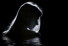 Sad Woman Profile Silhouette In Dark With Reflection On Water