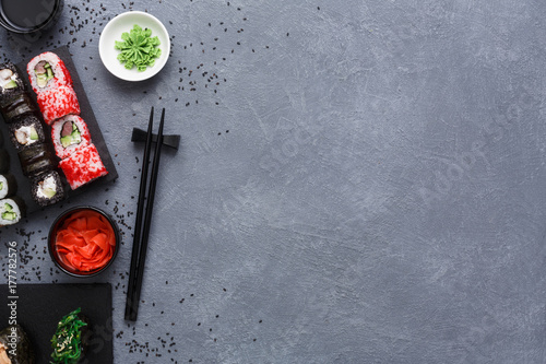 Foto op Aluminium Sushi bar Top view set of sushi maki and rolls on rustic grey and sesame background