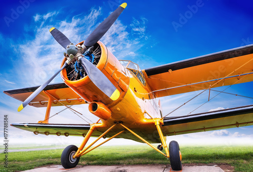 biplane against sky Canvas-taulu
