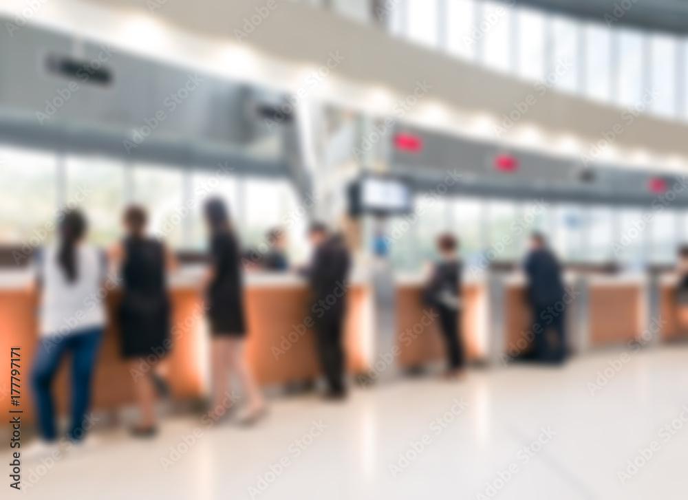 Fototapeta Blurred customer transaction in bank counter