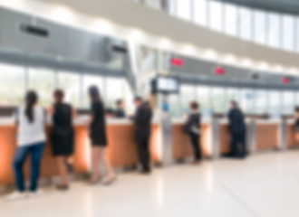 Blurred customer transaction in bank counter