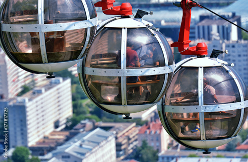 Spoed Foto op Canvas Gondolas The bubbles - gondola spherical cable car taking passengers from the center of city to the ancient Fort de Bastille