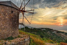 Beautiful Sunset. View Of The Island Of Patmos With A Windmill, Greece. HDR Processing.